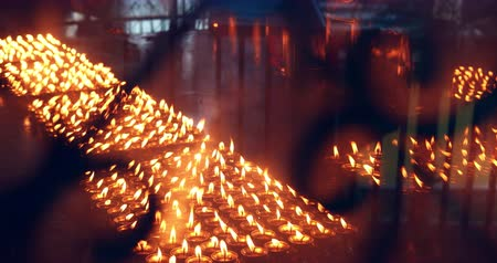 Candles burn in Buddhist temple. Spiritual religious background
