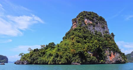 известняк : Traveling to rock islands overgrown with tropical trees in Thailand sea near Krabi and Phuket