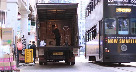 ekspres : Small business supply with delivery truck unloading goods in Hong Kong city downtown. Urban scene background