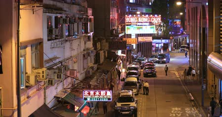 araç : Old Hong Kong district in Wan Chai area at evening. Urban scene and downtown view