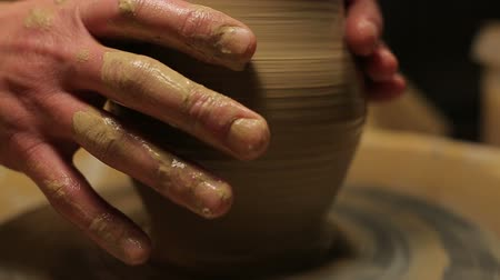 ügyesség : hands of a potter, creating an earthen jar on the circle