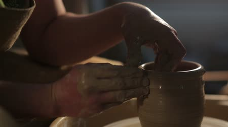 hrnčíř : hands of a potter, creating an earthen jar on the circle