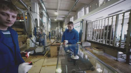 polyvinyl : Novosibirsk, 2016: Employees of the company are treated glazing. Mechnology of production double glass for PVC windows. Industrial production line of double glass. Production of plastic windows Stock Footage