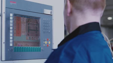 polyvinyl : Russia, Novosibirsk, 2016: Touch panel control at the company. Automated production. Operator panel production. Remote control. Modern technology in the workplace. Engineering controls production