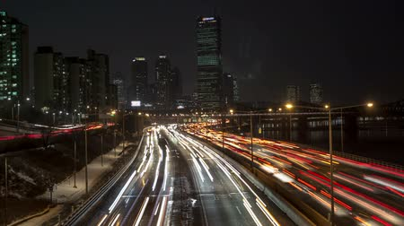 busy line : Seoul City Yeouido Downtown - Time lapse of traffic, cars and bridges in Yeouido Seoul Korea.
