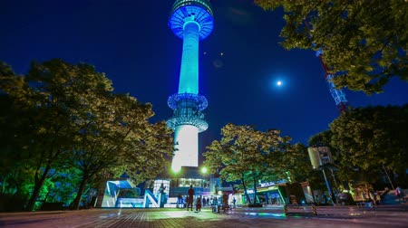 башни : Seoul Tower Night - Time lapse of people walking around at the icon building Seoul Tower.