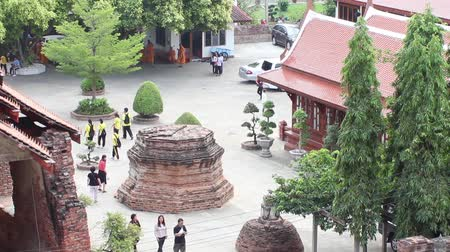 hacı : AYUTTHAYA, THAILAND - FEB 21, 2015: From the height of architectural structures seen tourists leisurely sightseeing. Many tourists visit Ayutthaya in February