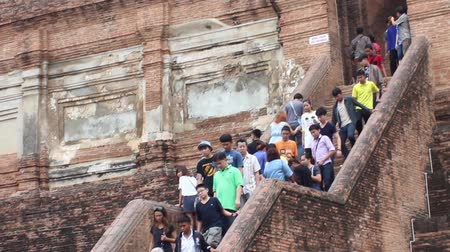 budha : AYUTTHAYA, THAILAND - FEB 21, 2015: Tourists descend the stone stairs to the ancient Buddhist buildings. Many tourists visit Ayutthaya in February Stock Footage