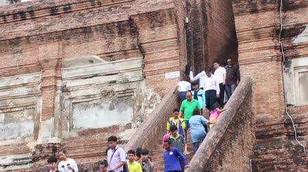 hacı : AYUTTHAYA, THAILAND - FEB 21, 2015: Tourists on the stone steps of the ancient Buddhist buildings. Many tourists visit Ayutthaya in February