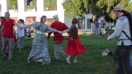 dancing people : Suzdal, Russia - Aug 26, 2018: Annual festival Summer of the Lord in Suzdal. Traditional Russian Round dance to the sound of a balalaika