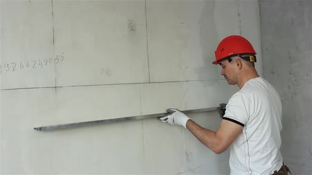 Foreman controls the quality of the construction of the partition