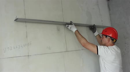 Builder controls the quality of the construction of the partition Stock Footage