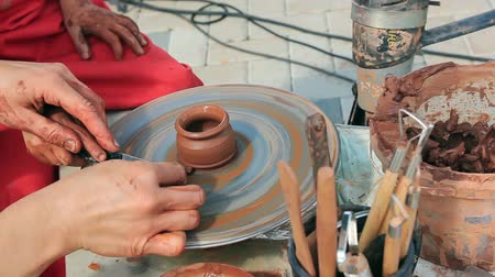 Teaching a child to work on a potter wheel, working with clay Stock Footage