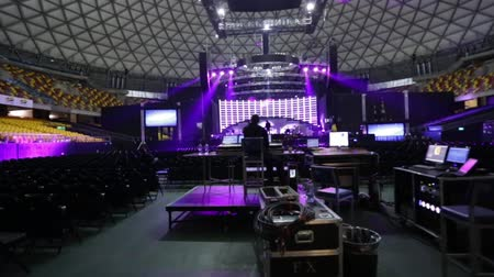 chaves : Lighting test before a concert at venue.  A dolly was used.  Purple lights are predominant