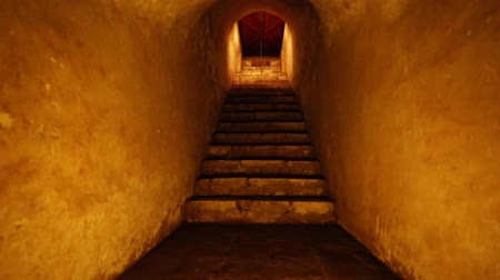 interiér : Beautiful shot of steps inside a narrow cave.  The lighting has orange tones.  Dostupné videozáznamy
