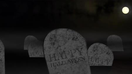 perili : Animation of tombs under moonlight with the words Happy Halloween Stok Video
