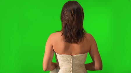 corredor : Back shot of bride as if she was walking down the aisle. Shot on Green Screen