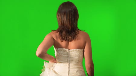 ona : Back shot on Green Screen of bride walking as she holds her dress