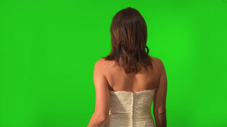gyönyörű nő : Shot on Green Screen, a beautiful bride walking away but turns around to flirt with the camera.