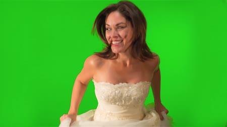 седые волосы : Shot on green screen, a happy bride running towards the camera on her wedding dress with her hair loose.