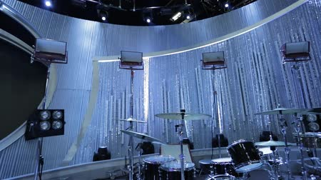 барабаны : Pan of Instruments on a Stage with Beautiful Beaded Curtain in the back.  Lighting is in Blue and White tones.