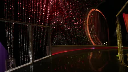 üres : Tilt up from Empty Stage with cool lighting and big, shiny beaded curtain