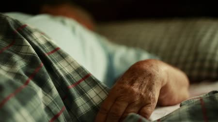 idősek : Beautiful shot of Unrecognizable Elderly persons Hands as she lays down in Bed.