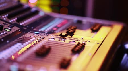 konsol : Selective focus of a digital audio console fader during evening performance