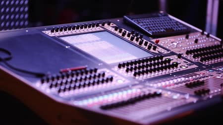 music show : Audio Mixing Console with Audio Engineer in front during Show