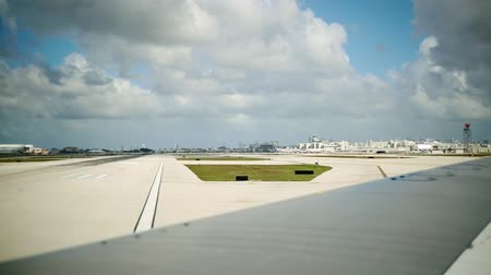 samoloty : Daylight shot of wing of an airplane before taking off.  Another plane can be seen in the runway Wideo