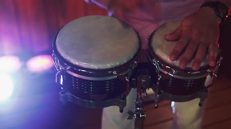 Close up of man�s hands playing congas, cool lighting