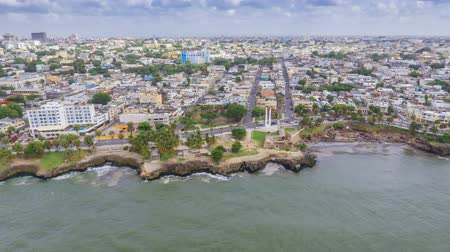 dominican : Aerial Hyperlapse shot of Caribbean island Dominican Republic during the day with beaches, streets, cars and the old city in the background