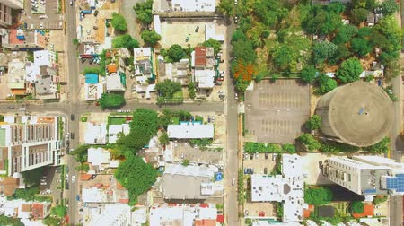 surroundings : Cenital Aerial shot of Caribbean island Dominican Republic with buildings and streets during the day