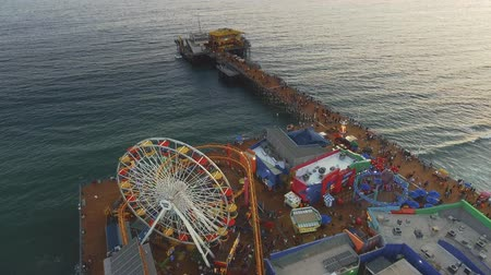 evez : Aerial shot over the rides in Santa Monica Pier in California right before sunset