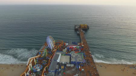 Daytime Aerial shot over Santa Monica Pier and moving towards the Ocean in California