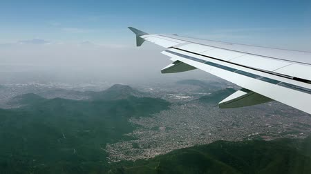 mexico city : Daytime aerial View from an airplane as it approaches Mexico City. Mountains and homes can be seen.