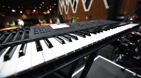 Close-up shot of a keyboard on stage before a concert, shot taken from backstage