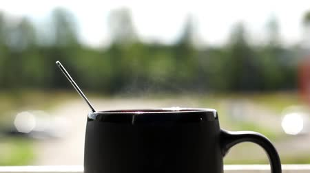 otthonos : Smoke from a cup of hot coffee
