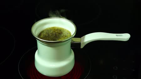 Brewing coffee in a coffeepot