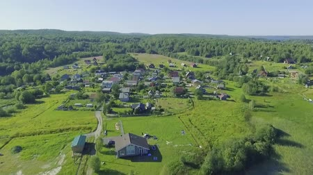Aerial view of houses in counrtyside Wideo