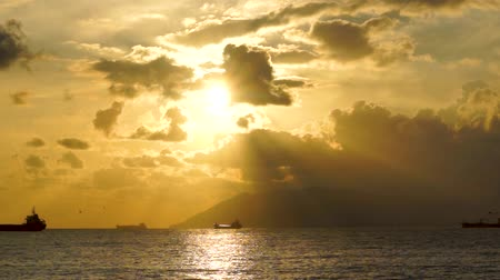 Magnificent scenery and ships in the sea at drammatic sunset