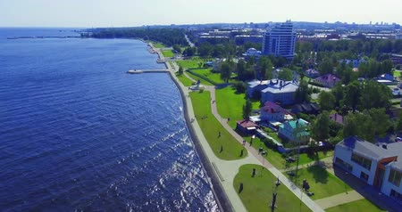 Aerial view of city lake embankment forward