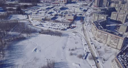 szállás : Cars and houses on city outskirts in winter aerial view