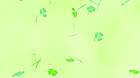 Loop vertical fast rotation Clover leaves bright background Wideo