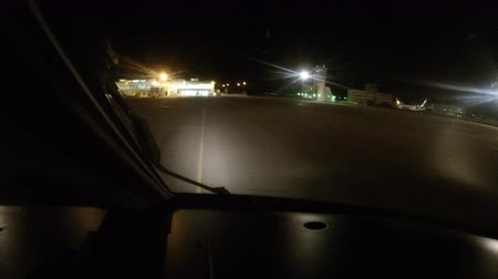pilot in command : Plane landing at the airport during the night. the view from the cockpit