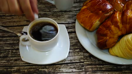 kultúra : Cup with turkish coffee on the table with traditional delights on the background.