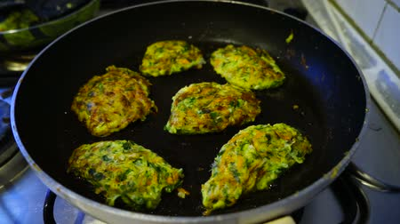 white onion : vegetarian meatballs, greens and fried in a pan