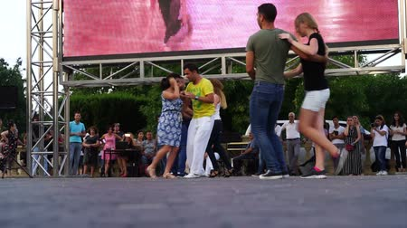 Baku, Azerbaijan - 27 May 2017: City Festival people enjoy dancing on street, crowd reiterate movements after dance trainer outdoors Dostupné videozáznamy