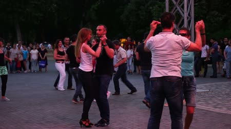 Baku, Azerbaijan - 27 May 2017: City Festival people enjoy dancing on street, crowd reiterate movements after dance trainer outdoors Wideo