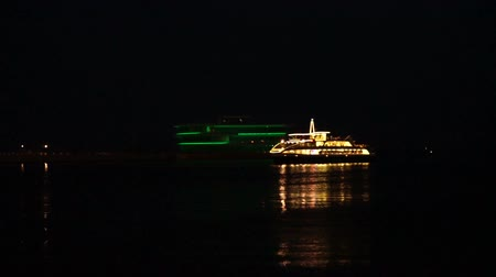 Passenger pleasure boat stands at the pier at night Dostupné videozáznamy